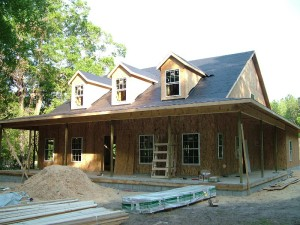 "5-Once the home framing process is complete, the exterior windows and doors are installed, and the underlayment is installed on the roof, the home is considered ""dried-in,"" or weather-tight."
